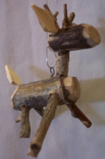Hand carved reindeer ornaments By: Michael Salazar - Click Image to Close
